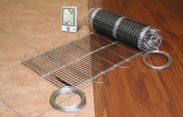 Электрический теплый пол под ламинат – виды, какой выбрать и произвести монтаж